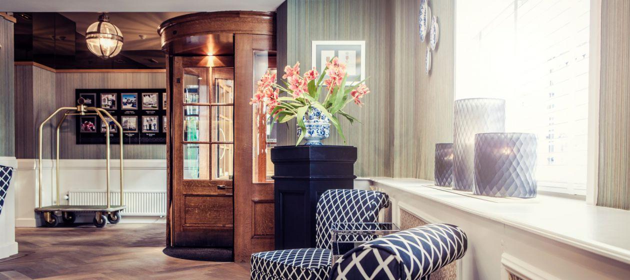 9. Carlton_Ambassador_Hotel_Reception_InPixio.jpg